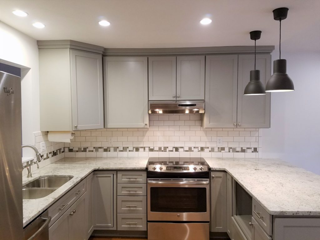 A second view of the kitchen, cabinets, and countertop