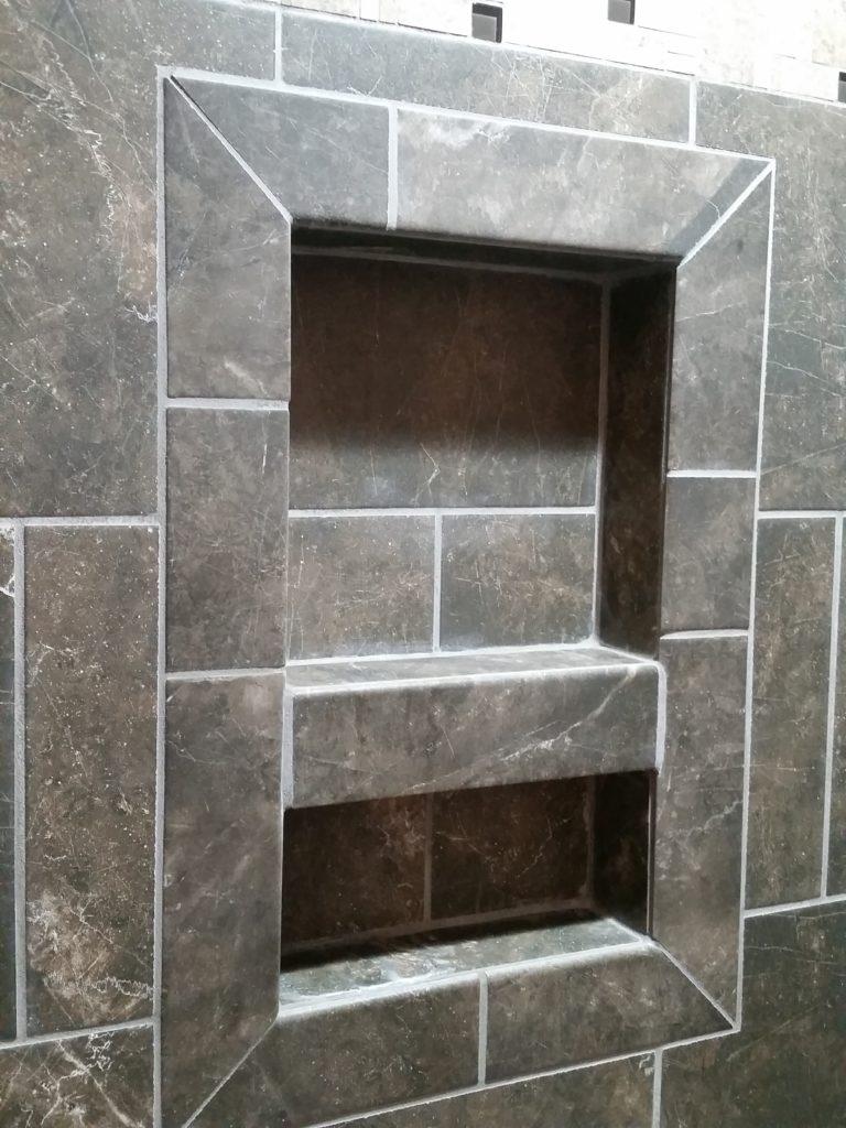 A close-up of the shower shelf.