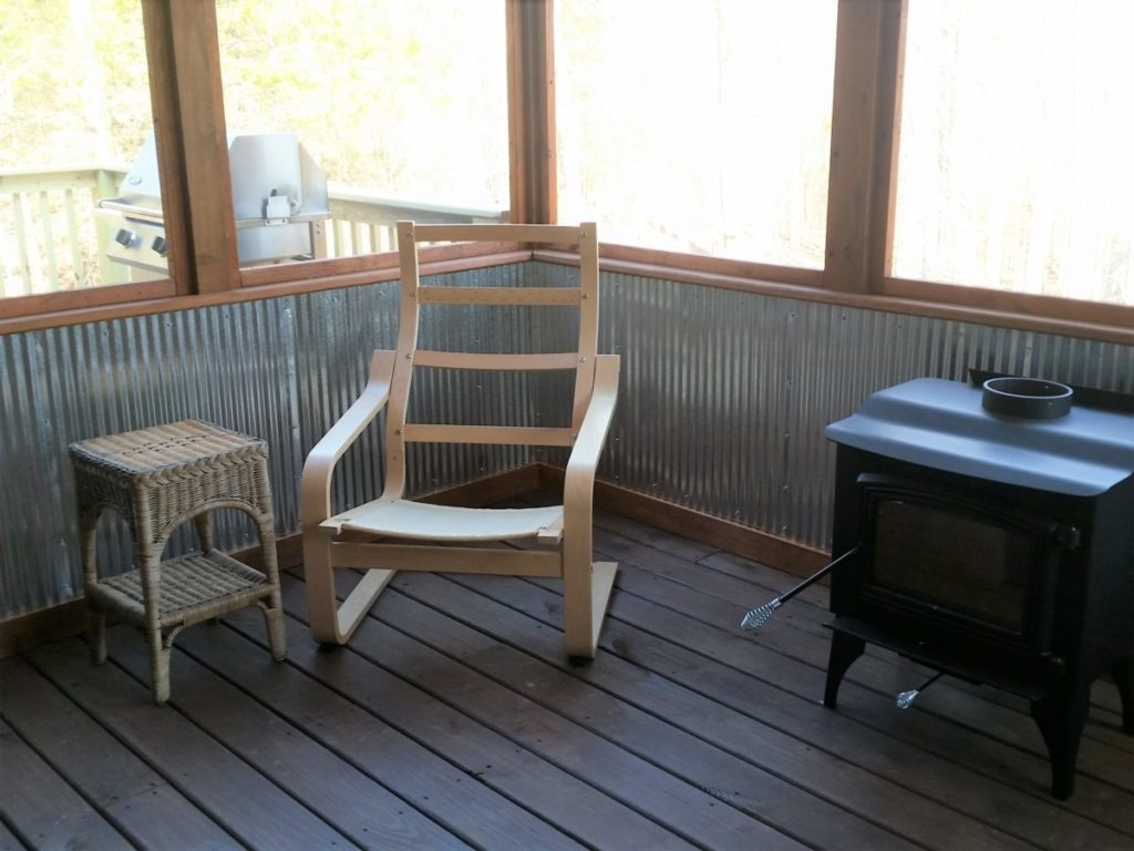 A corner of the inside of the screened-in porch.