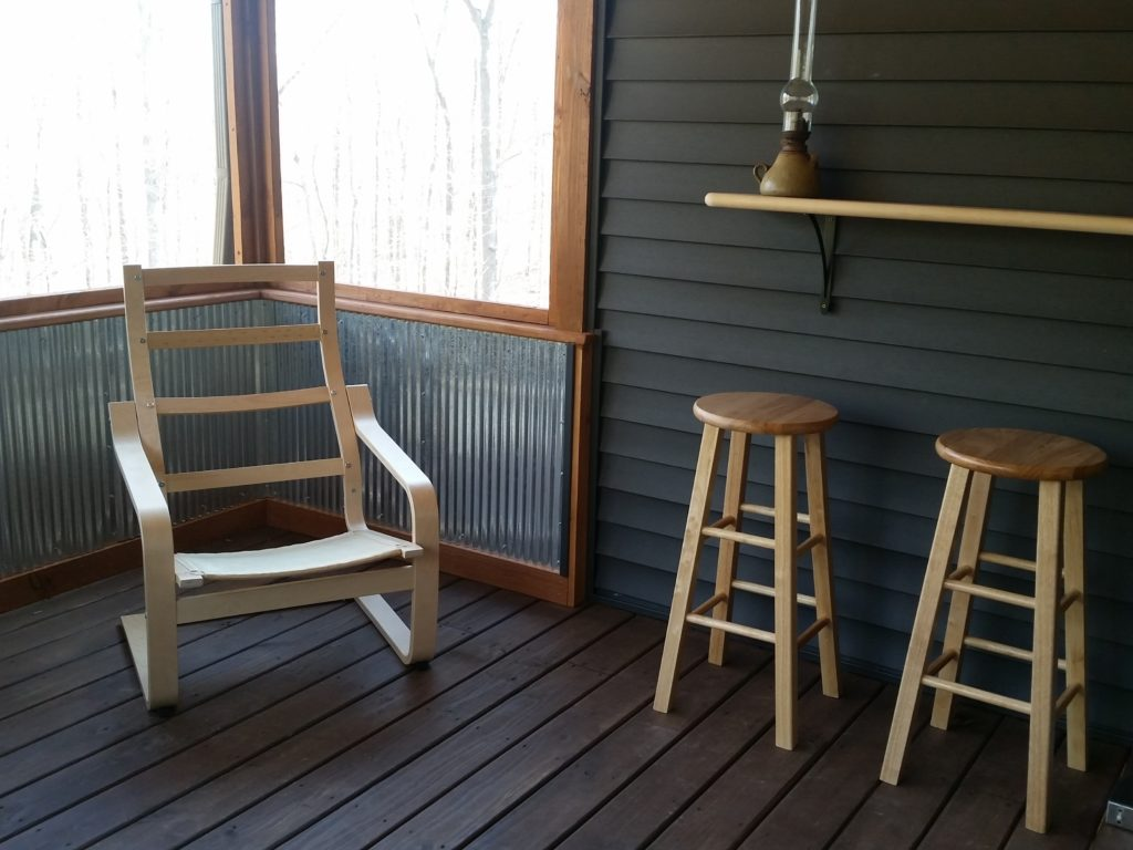 A view of another corner of the inside of the screened-in porch.